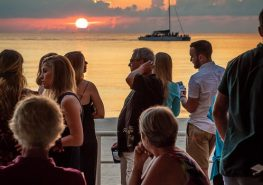 people at event at sunset