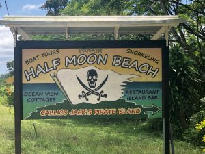 Half moon beach sign
